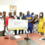 Some Executives and staff of MTN presenting the cheque to the Hon. Minister of Communications and Digitalization and her team
