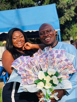 Anokyewaba with Asempa as he displays the surprise money bouquet